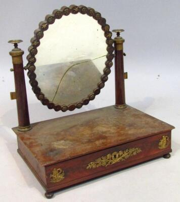 A 19thC French Empire style mahogany and gilt metal table mirror