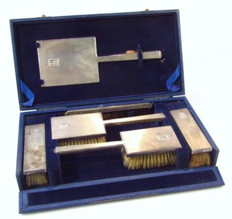 A George VI silver dressing table set