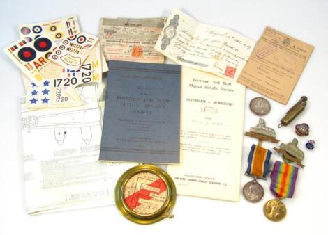 Various WWI medals and associated badges