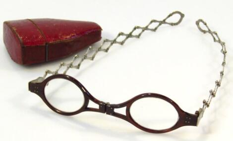 A pair of 19thC tortoiseshell and white metal folding spectacles