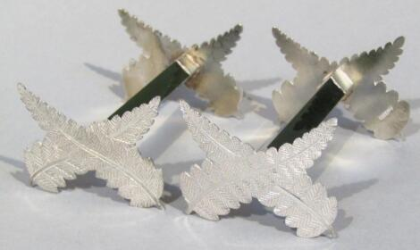 A pair of white metal and jade knife rests
