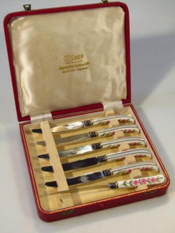 A cased set of pistol handled knives