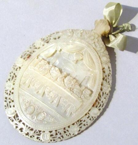 A 19thC nacre mother of pearl carved shell
