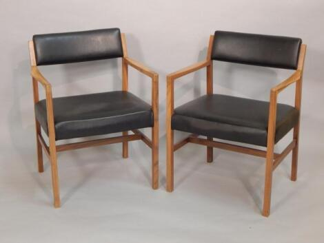 A pair of R Foster & Sons Retro walnut open armchairs