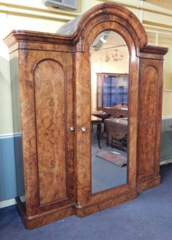 A Victorian figured walnut breakfront wardrobe