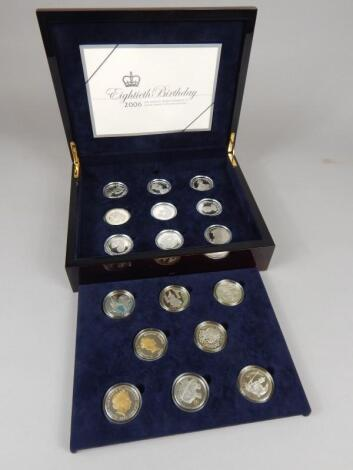 A set of seventeen silver crowns