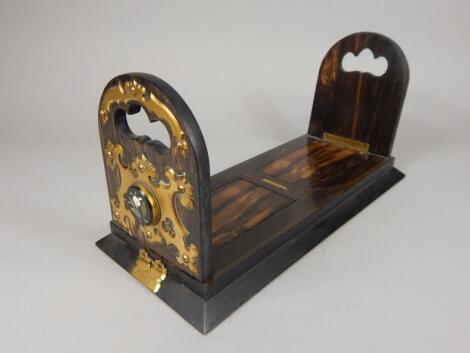 A Betjeman's patent calamander and gilt brass mounted book slide