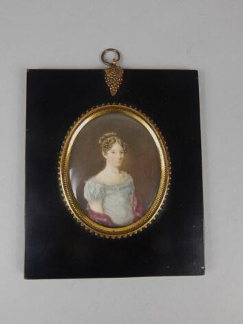 19thC School. Portrait miniature of a lady wearing a blue dress with shawl