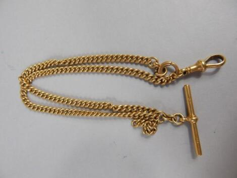 An 18ct gold watch chain with T bar