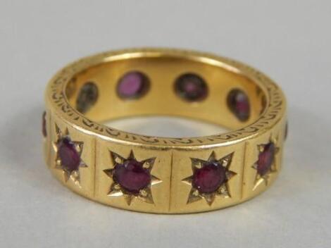 An 18ct gold garnet ring