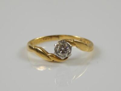 An 18ct gold diamond twist ring