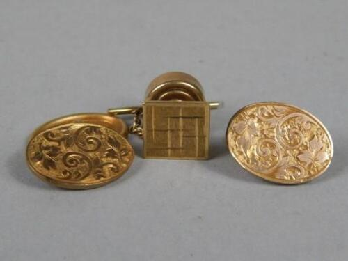 A pair of 9ct gold cufflinks and a tie pin