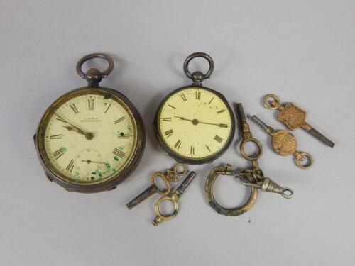 Two silver pocket watches and advertising keys