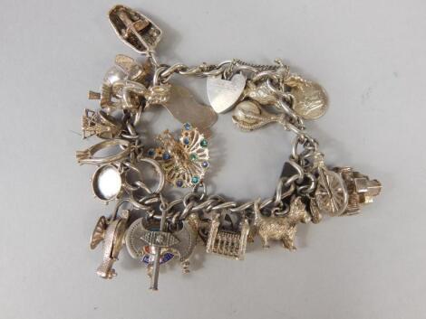 A white metal charm bracelet
