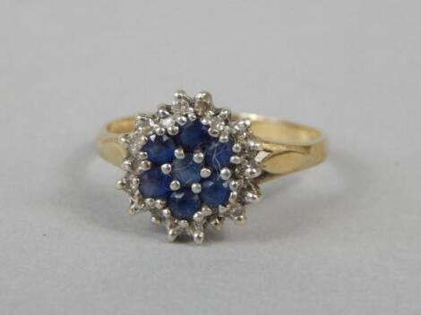 A sapphire and diamond cluster dress ring