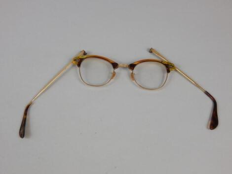 A pair of simulated tortoiseshell spectacles