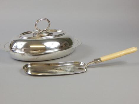 A silver plated oval tureen and a Edwardian silver plated chrome scoop