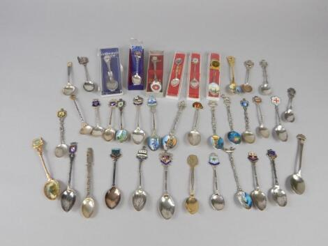 A large quantity of Continental white metal and other souvenir spoons