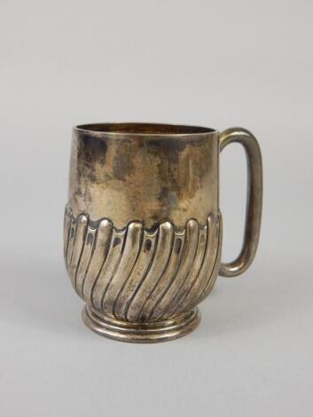 A George V silver part fluted christening mug
