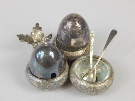 A Chinese white metal acorn shaped cruet