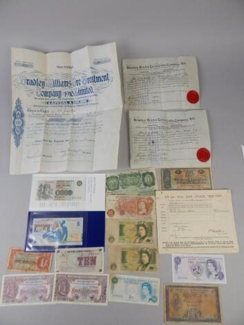 A quantity of UK bank notes and share certificates