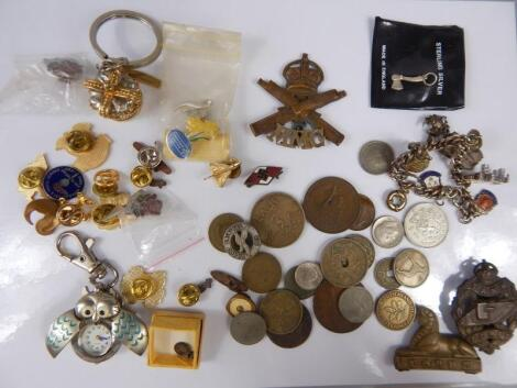 A quantity of enamel badges