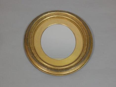 A late 19thC gilt gesso oval wall mirror