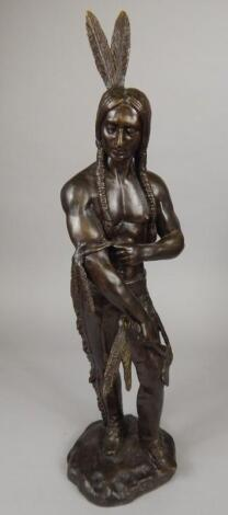 A modern bronze figure of a native American Indian warrior