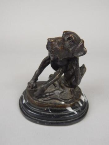 After Fratin. A modern bronze figure of a hound scratching