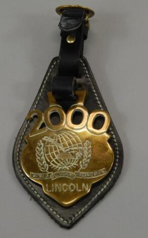 A Lincoln Ploughing Organisation horse brass for year 2000.
