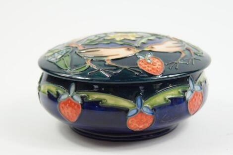 A Moorcroft Pottery powder box and cover decorated in The Strawberry Thief pattern