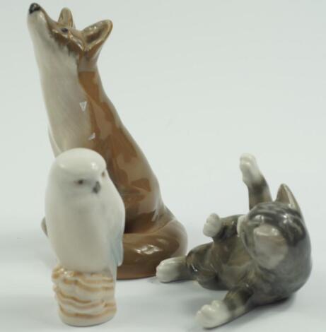 A Royal Copenhagen porcelain figure of a seated fox