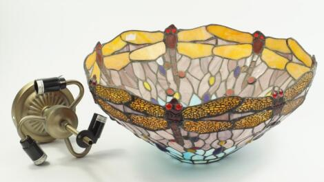 A Tiffany style glass ceiling light decorated with dragonflies