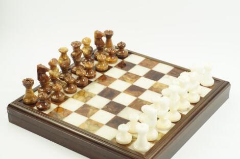 An Italian white and brown onyx chess set
