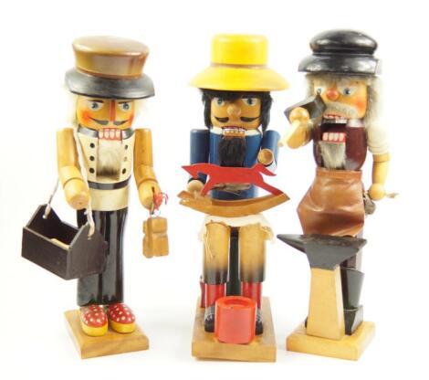 Three German wooden figural novelty nut crackers
