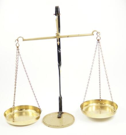 A set of cast iron and brass balance scales