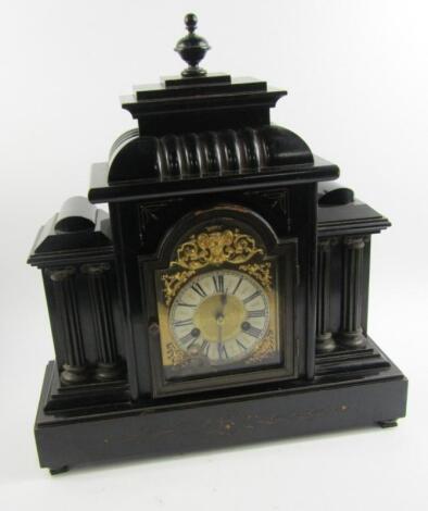 A Victorian ebonised mantel clock