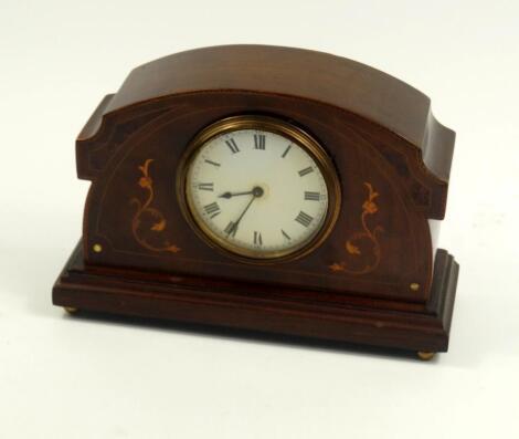 An Edwardian mahogany and inlaid mantel clock