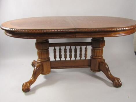 An oak draw leaf dining table