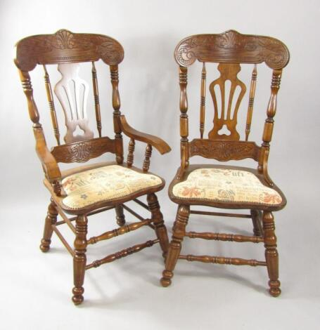 A set of eight oak dining chairs with carved crest rails