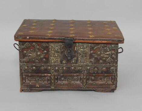 An Indian hardwood box with brass studded and overlaid decoration