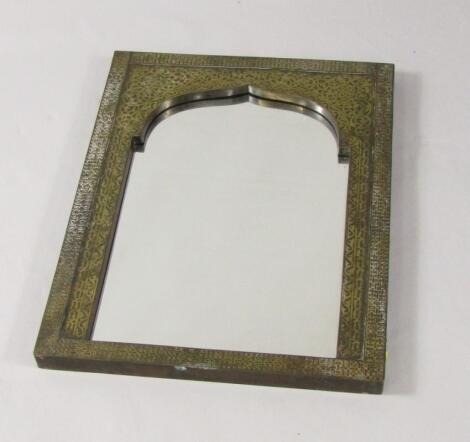 An Indian hardwood and brass inlaid wall mirror