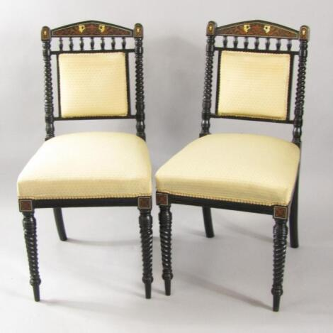 A pair of Victorian ebonised single dining chairs
