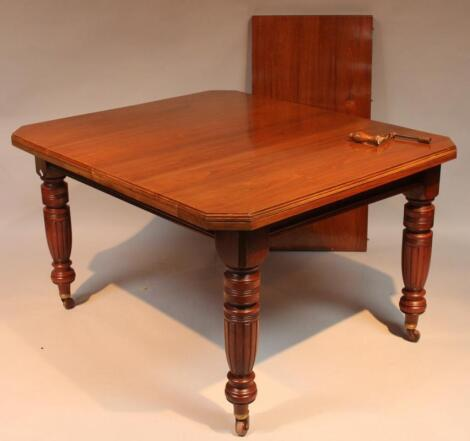 A late Victorian walnut dining table