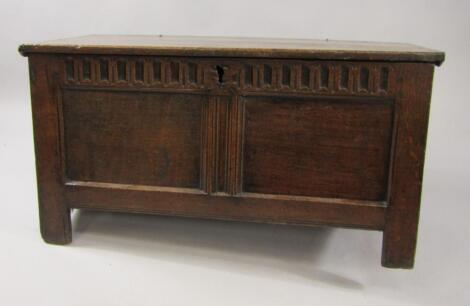 A 17thC oak coffer with a carved panel front