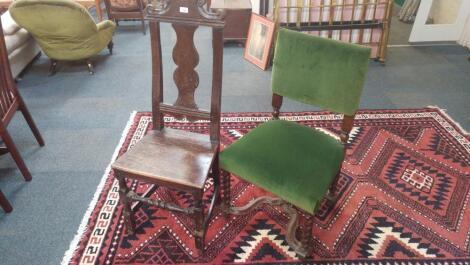 An 18thC oak hall chair