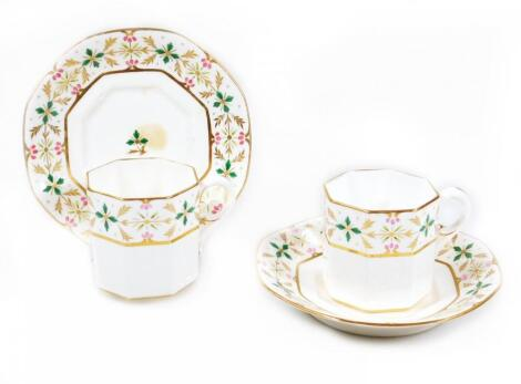 A pair of early S & H King Street Derby porcelain octagonal coffee cups and saucers