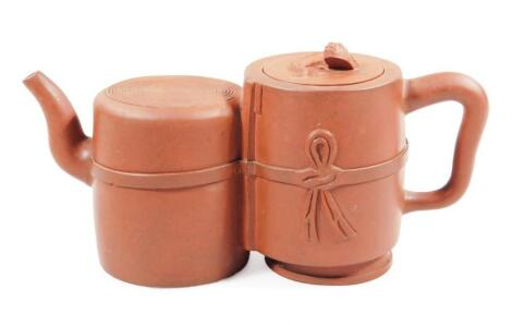A Chinese red ware Yi Xing double teapot