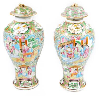 A pair of 19thC Chinese baluster vases and covers
