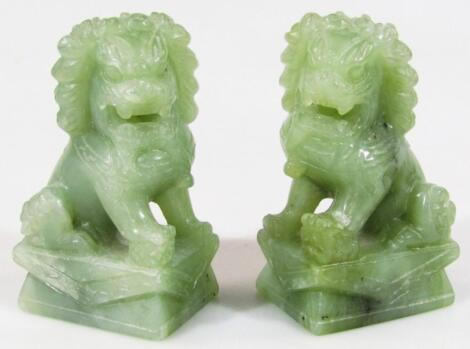 A pair of 20thC Chinese jadeite figures of Dogs of Fo